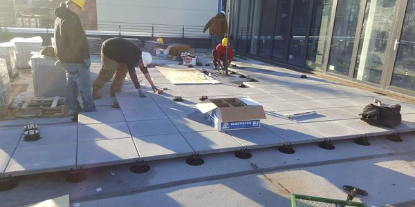 Myrtle Avenue Brooklyn New York 5,000 square ft Installation of Concrete Pavers with pedestals
