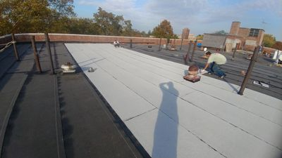 Freeport New York torch down 2ply commercial roofing white cap sheet Firestone Installation
