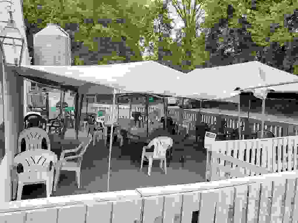 The Cricket Hill brewery outdoor beer garden holds approximately 35 people to enjoy craft beer!
