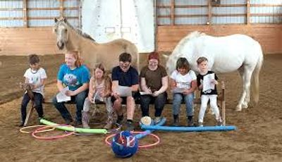 A group of students work with the horses to enhance their communication skills.