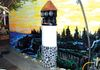 This is my back walkway..I don't have a yard...There was an old Electric trio panel...So we took three coffee cans, punched them and put lights in them..yes it works..the lighthouse is a paper barrel cut in half and lint for the rocks..This pic is after 8 years after we made this.