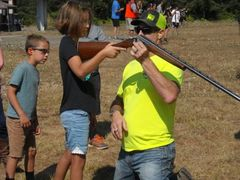 Lonnie Sizer certified gun safety instructor, introduces first time shooters to the shotgun