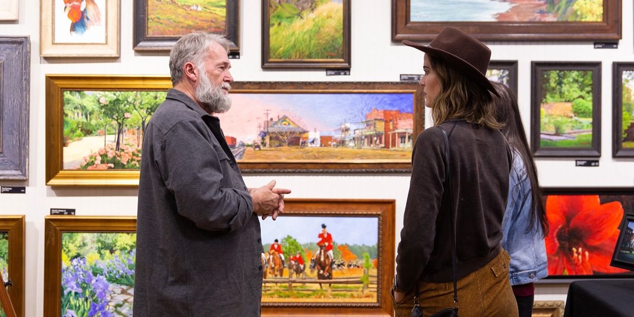 Artist & gallery owner Frank Pierce talks to guests during an Open House.  Photo ©2019 Kiley Loesch.