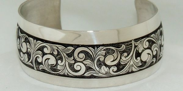 Below are several examples of items Barry Golden has hand-engraved, along with hand-made jewelry.
