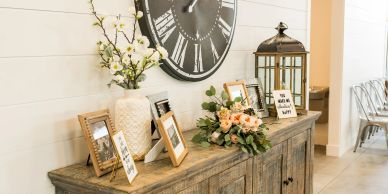 table with flowers and picture frames