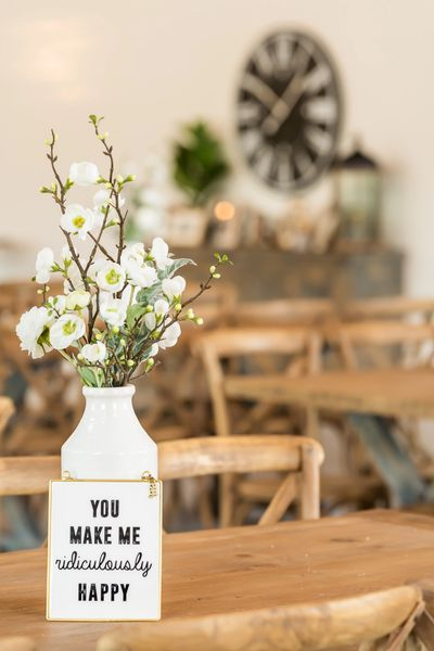 flowers in a vase on a wooden table