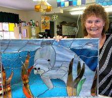 Carol and her Manatee stained glass.  Carol takes lessons here and if you are interested contact me.