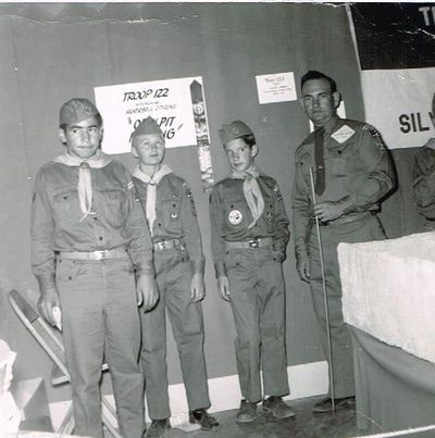 Frank Sanchez, Steve Jameson and Alan Reiner stand with Herb Cleaver, their Scout leader.