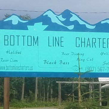 Photo of Bottom Line Charters sign
