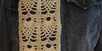 Crochet pattern for a lacy scarf made using pineapple stitces