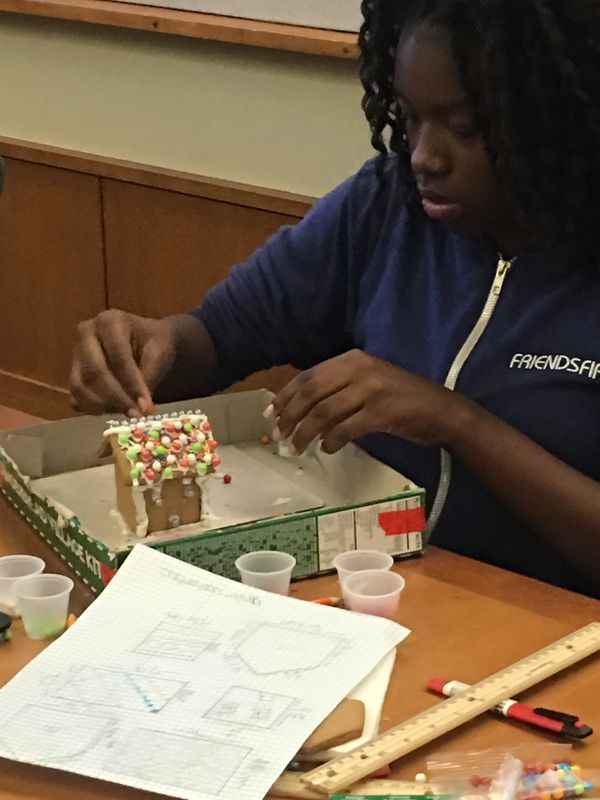 Building a gingerbread house that she first designed to scale!