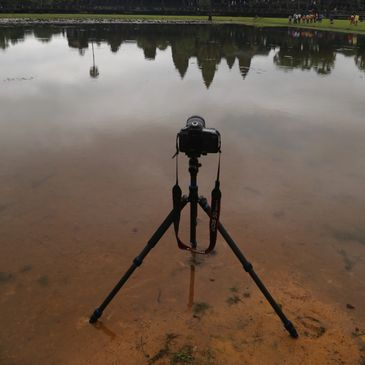 One of my Canon cameras taking a picture of sunrise at Angkor Wat in Cambodia