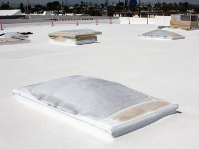 SPF self-flashes around roofing details on a low-slope  ​commercial roofing system