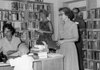 1962, Ms. Elena Percy checks out books to patrons