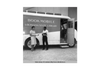 April 25, 1961- Two library assistants standing by the  Audubon Regional Library bookmobile