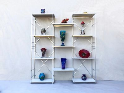 collapsible metal shelving bookcase unit, 6' high by 6' wide and 1' deep.  portable display shelving with art glass on display