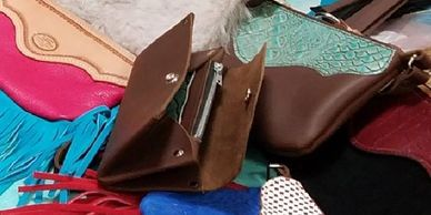Handmade leather purses, clutches, wallets and backpacks.