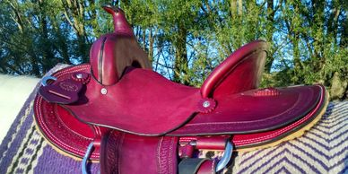 Custom leather saddle handmade in Minnesota, horse tack, dog collars, leash, saddles bags and more.