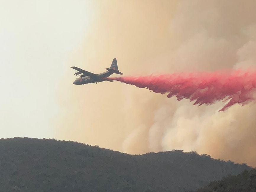 Fire Fighting plane drops Fire Retardant  on the northern perimeter of El Cariso Village- Holy Fire