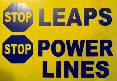 STOP LEAPS Power Lines sign