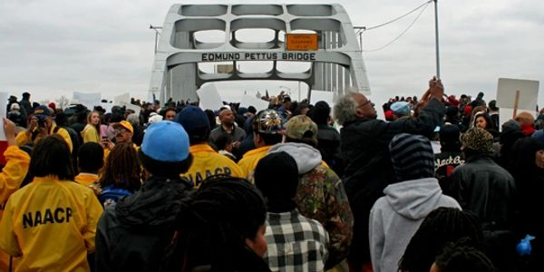 A large crowd crossing the Edmund Pettus Bridge in Selma, Alabama for the annual Bridge Crossing.