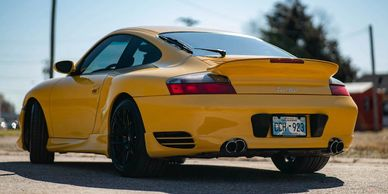 Rear view of 2003 Yellow Porsche 911 Twin Turbo