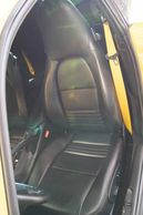 Driver's seat showing yellow seatbelt of Porsche 911 Turbo