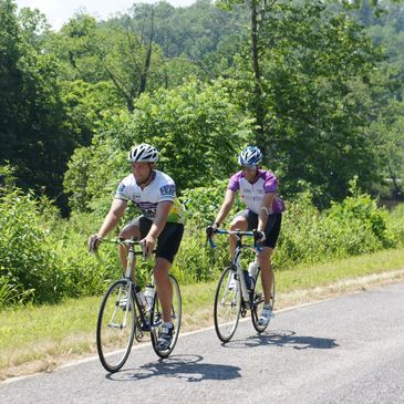 Two bicyclists cycling on marked bicycle routes