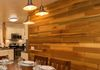 The living/dining area features two beautiful accent walls, one of reclaimed poplar boards in the dining area, and the other of reclaimed chestnut boards in the living area
