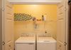 The easy access laundry closet features top-of-the-line HE appliances (detergent provided), iron, and ironing board