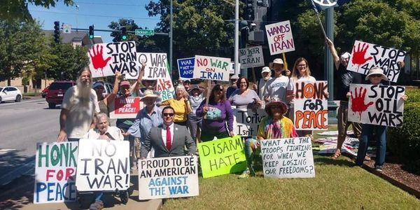 Anti War protest outside the Washington County Courthouse in Fayetteville Arkansas