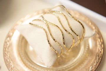 Gold Paragon Straps Cuff by Jewelry by Sara Blaine in the boutique. Photographed by Kevin Harkins