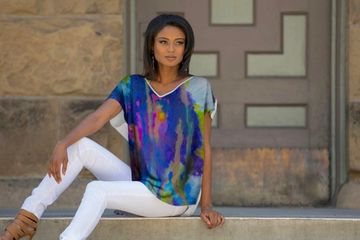 Purple Watercolor V-Neck. Best selling blouse. Various shades of purple, violet, indigo, fuchsia, yellow, and blue with a beige back. Fits loose and airy. Back is longer than the front.