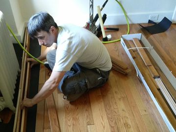 Hardwood Floor Installation. Red oak. Preparing for a very tricky under the radiator install.