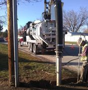 American Vac Services trenching for power contractor