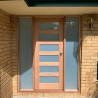 twin sidelite jamb set frame with 6 lite translucent glass timber door.