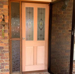 Kookaburra timber door with knob entrance handle.