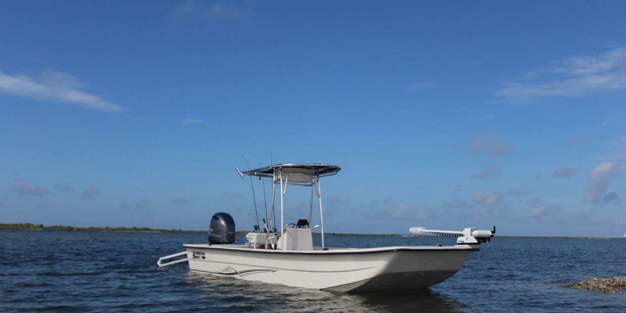 Charter boat Carolina skiff T top center console