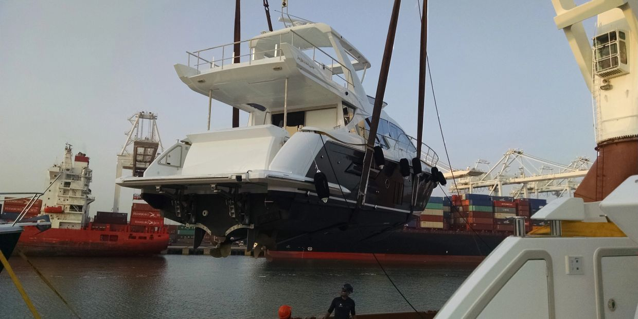 Removing boat off ship in New Jersey