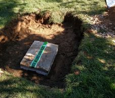 Septic components located and uncovered during a Title 5 inspection in Sterling