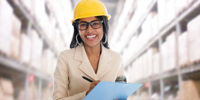 Women in warehouse monitoring temperature