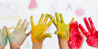 happy hands doing creative work at our child care