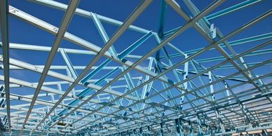 A large metal roof structure created using fabrication services