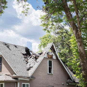 Damage to a roof caused by a tree branch that broke of during the tornado in Salt Lake City in 1999