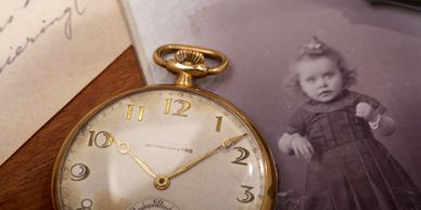old photograph and pocketwatch