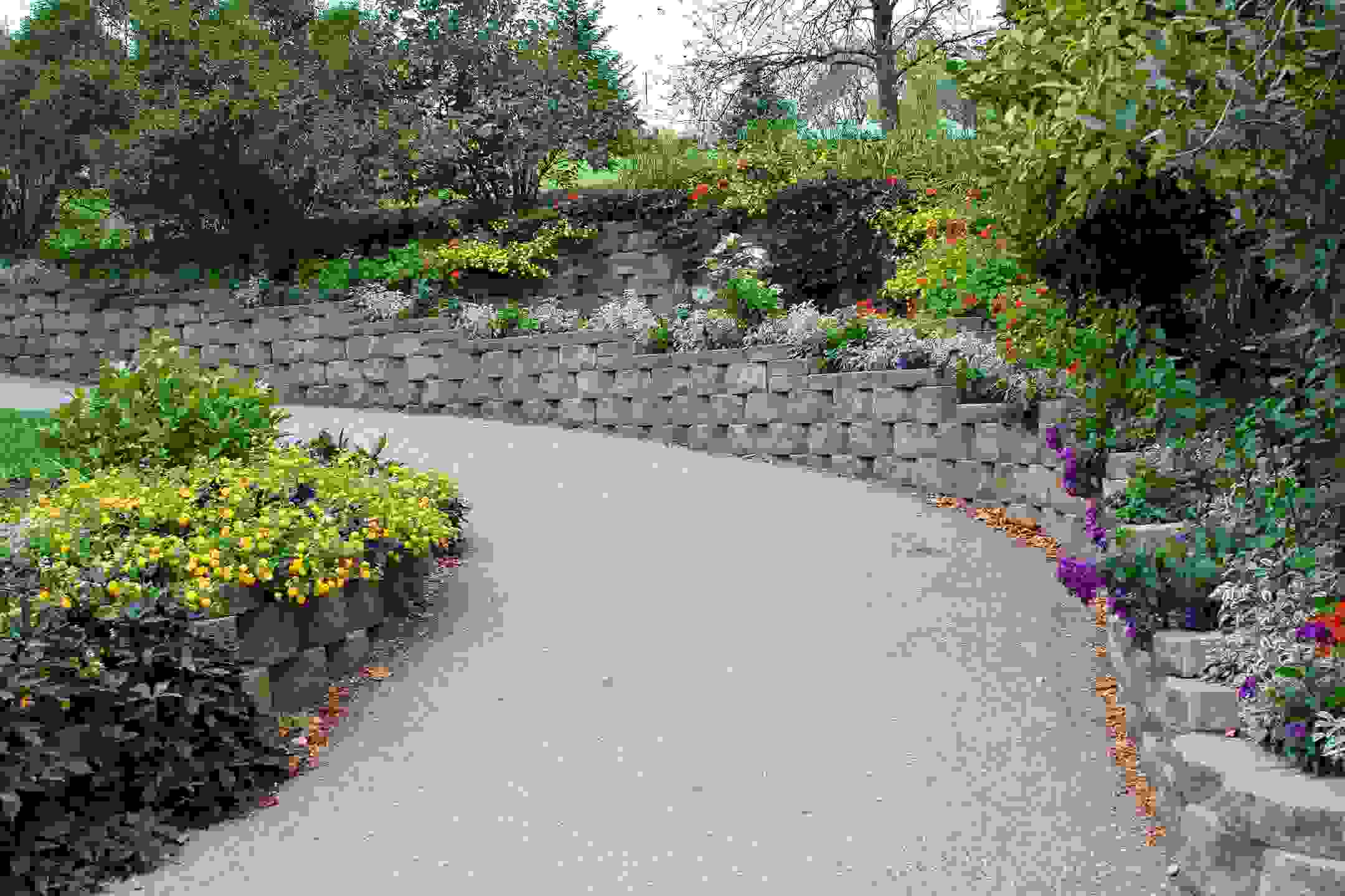 wrap around retaining wall surrounds driveway