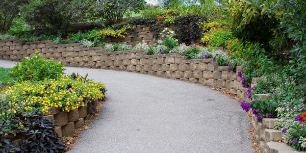 Multi-level landscaping with brick paver retaining walls