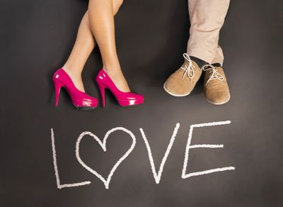 Pink high heels and beige shoes with love written underneath