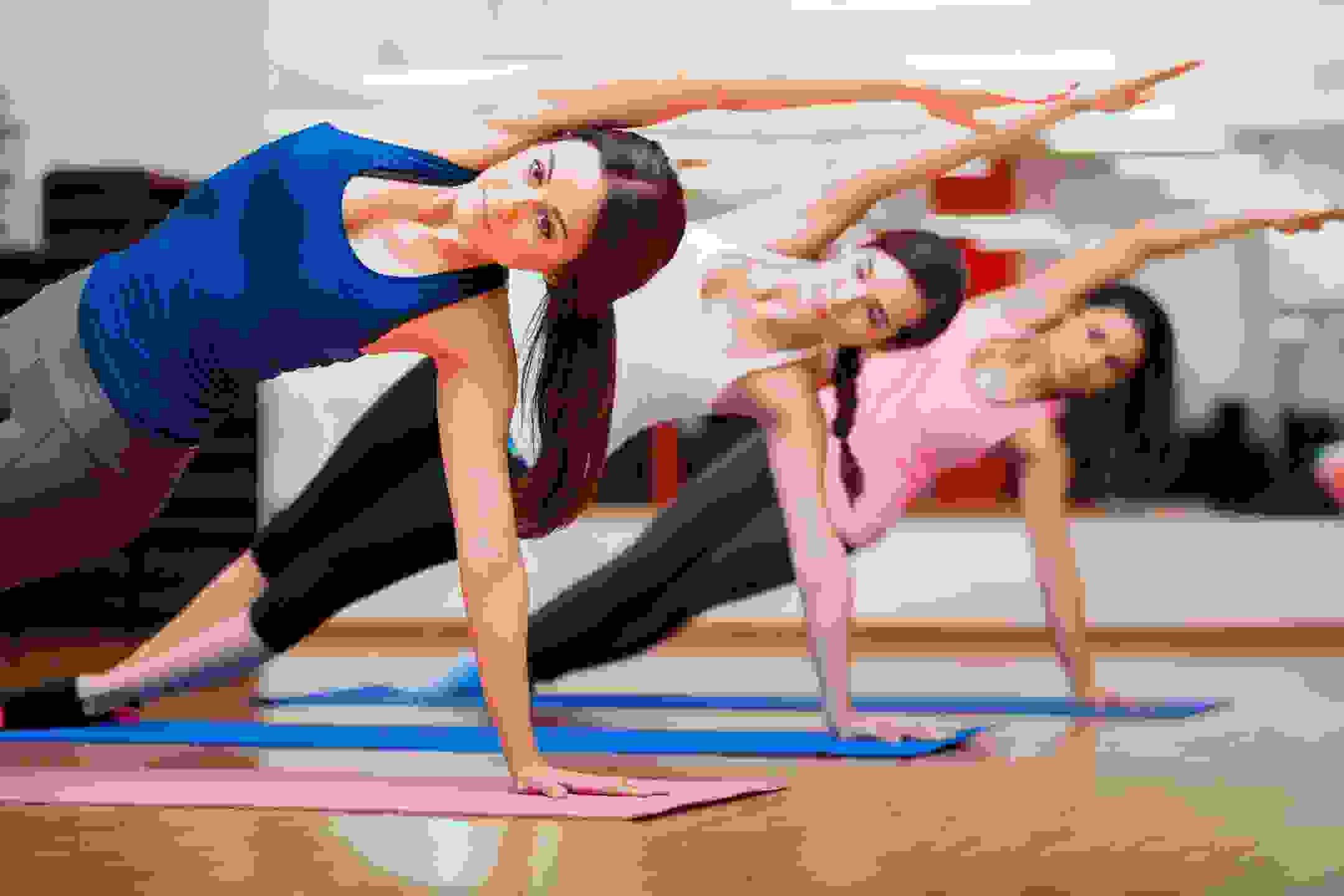 3 women doing floor exercises for health and fitness