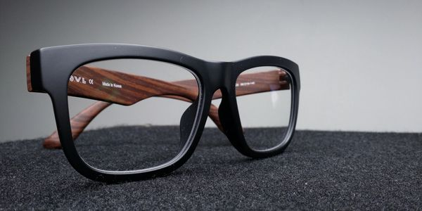 Maui Jim mens eyeglasses sitting on a black table